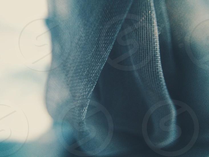 Macro shot of textured blue fabric. photo