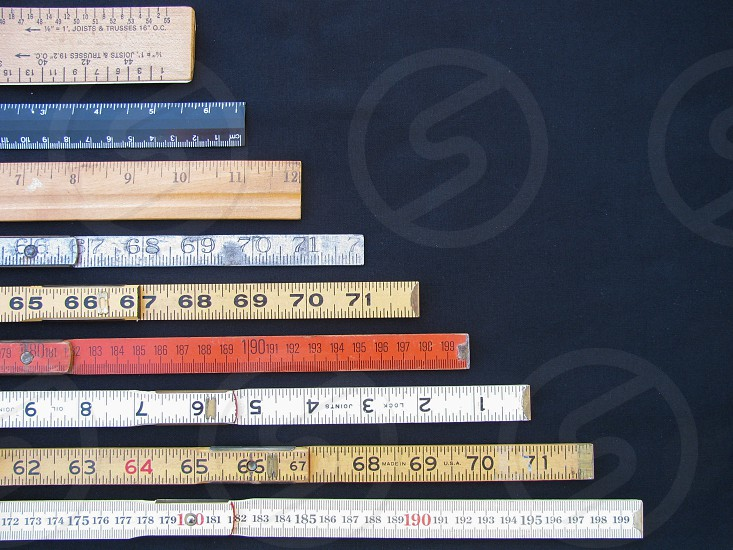 A collection of rulers and scales in metric and inches concepts of measurement accuracy and results with copy space. Small values at top large values at bottom. photo
