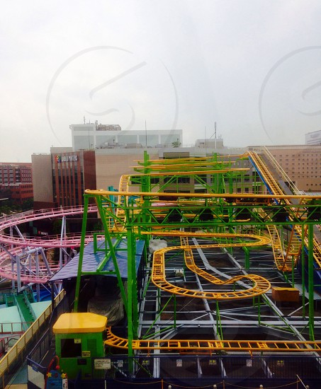 yellow and green roller coaster photo