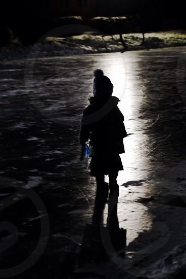 Child shadows black and white ray of light lonely innocence dark night   photo