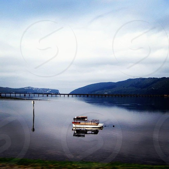 Lonely Boat on Lake photo