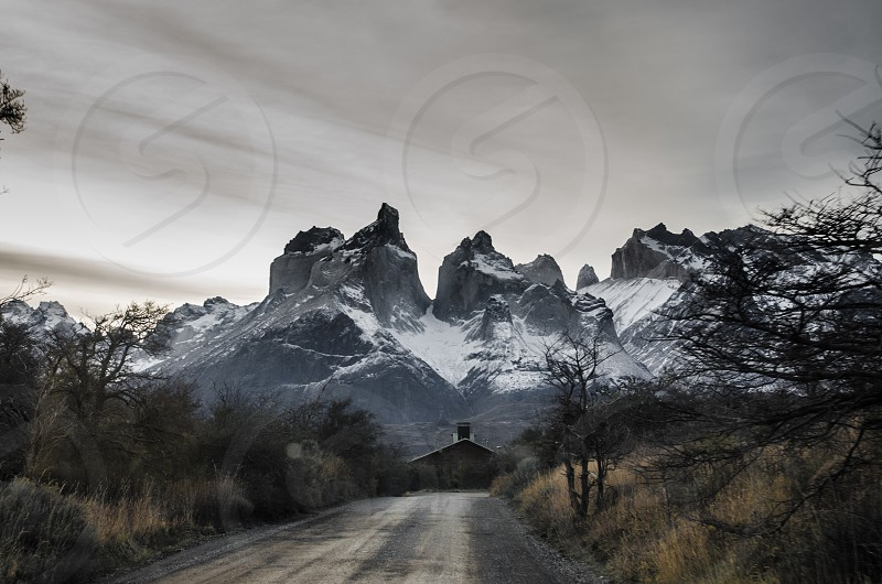 mountains road travel tourism torres del paine snow winter house solitude alone mood ambient nature landscape location chile magallanes photo