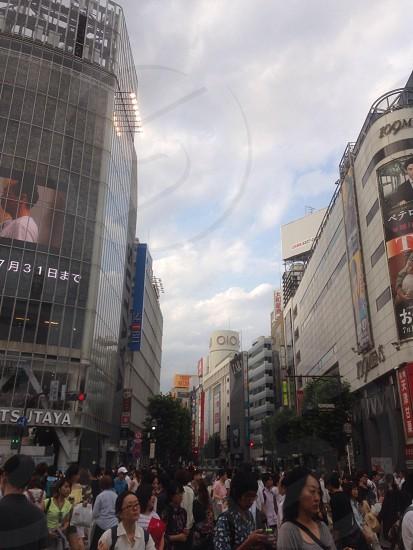 people near gray buildings photo