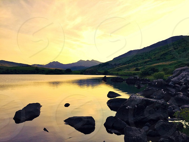 Evening sunset image over water photo