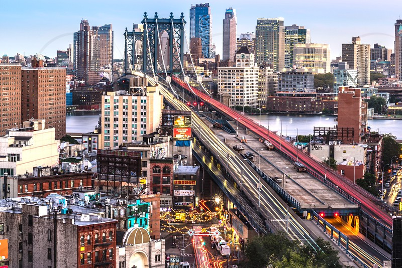 manhattan bridge crosses  the river of east river in new york photo
