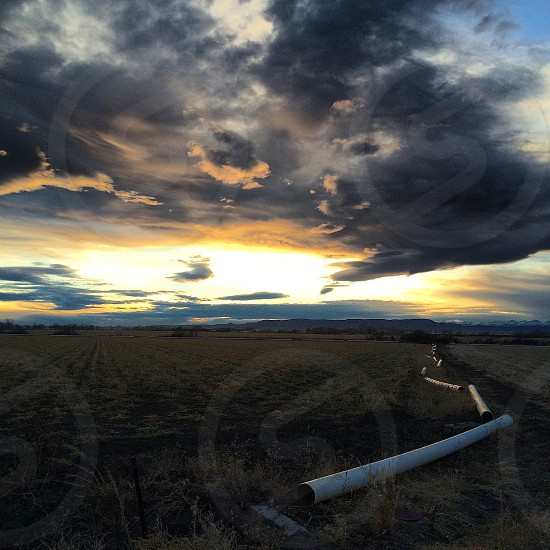 photo of white pipes during sunset photo