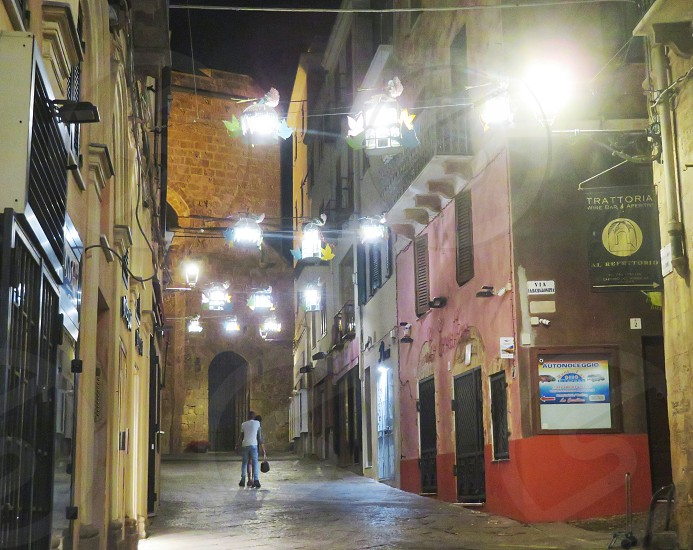 lovers in middle of italian street - Alghero Italy photo