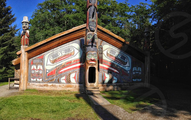 brown white native american themed house under blue skies during daytime photo