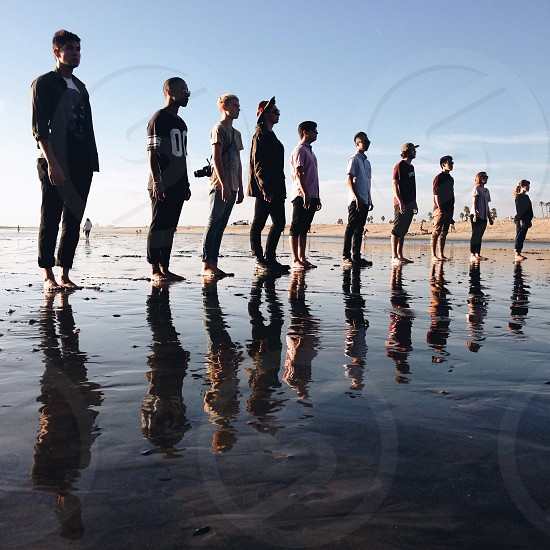 10 people standing at the beach photo