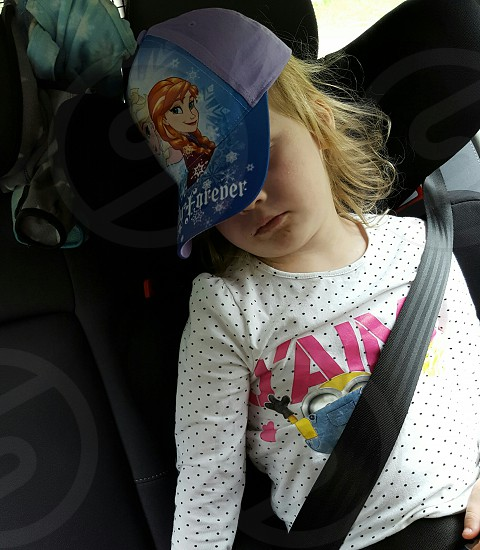 Sleeping in car after a day at the zoo. photo