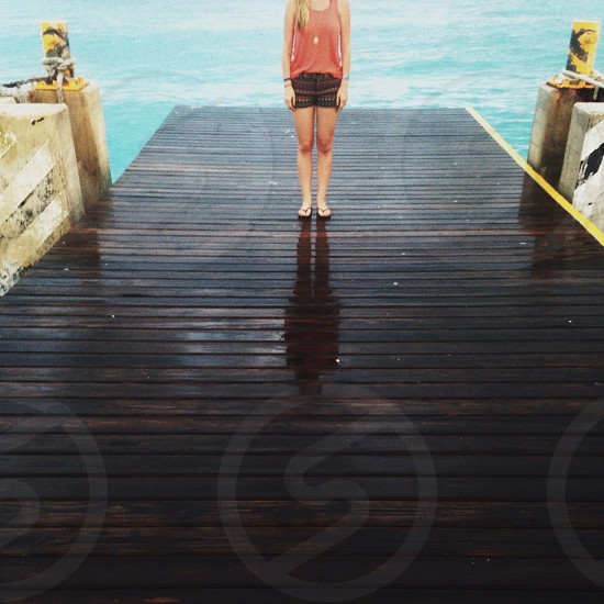 woman standing on dock photo