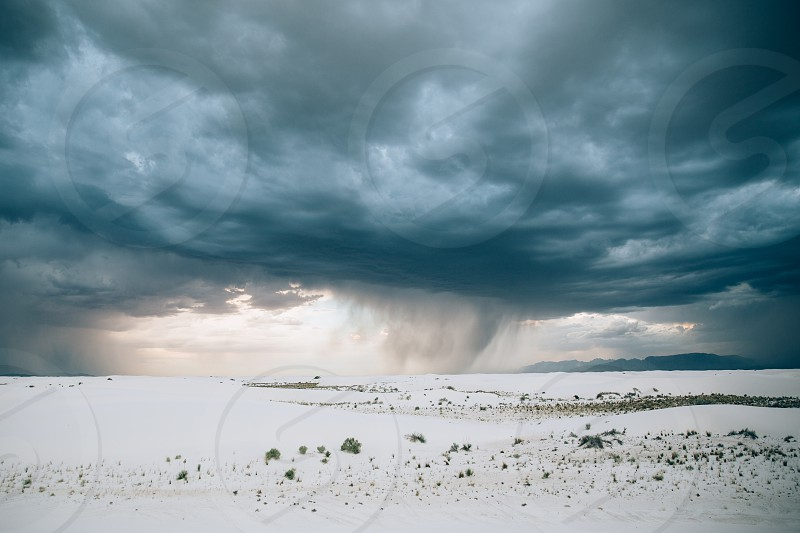 white snow covered plains under gray and blue cloudy sky time-lapse photography photo