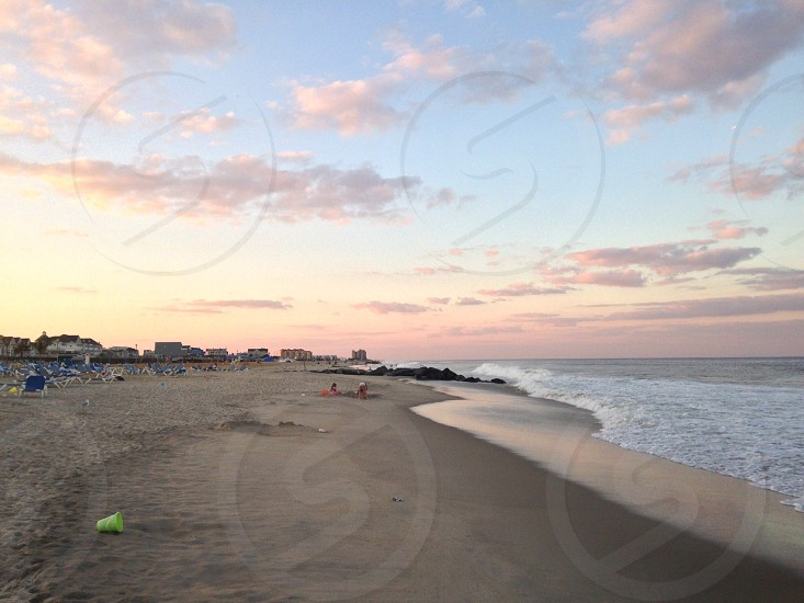 Beach sunset Jersey Shore colorful sky clean water kids playing relaxation photo