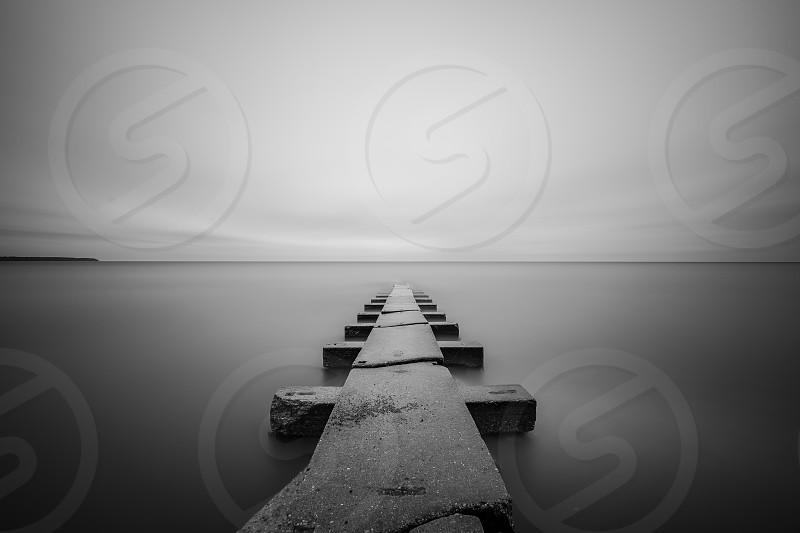 Pier; black and white; water; long exposure; Milwaukee; Wisconsin; blank space; jetty; Lake Michigan; photo