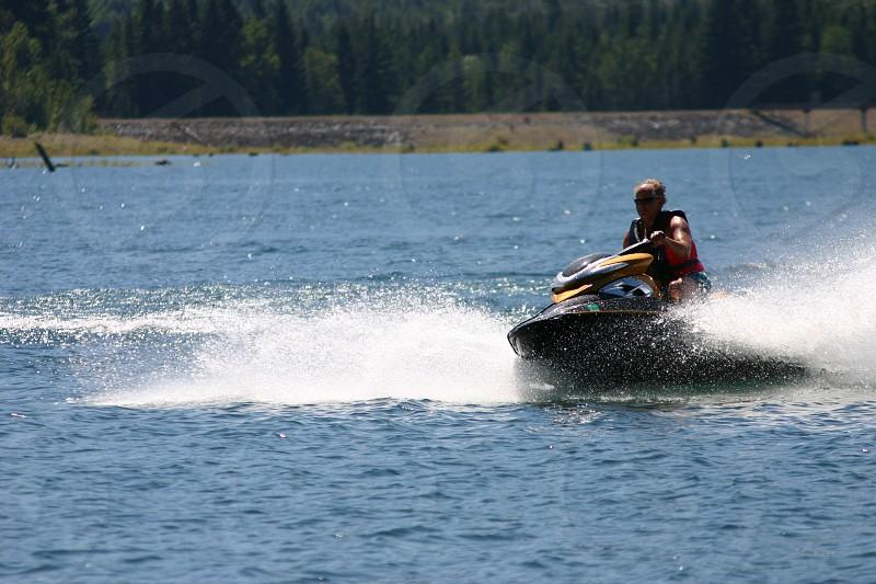 jet ski water splash sports water sports older man lake spray photo
