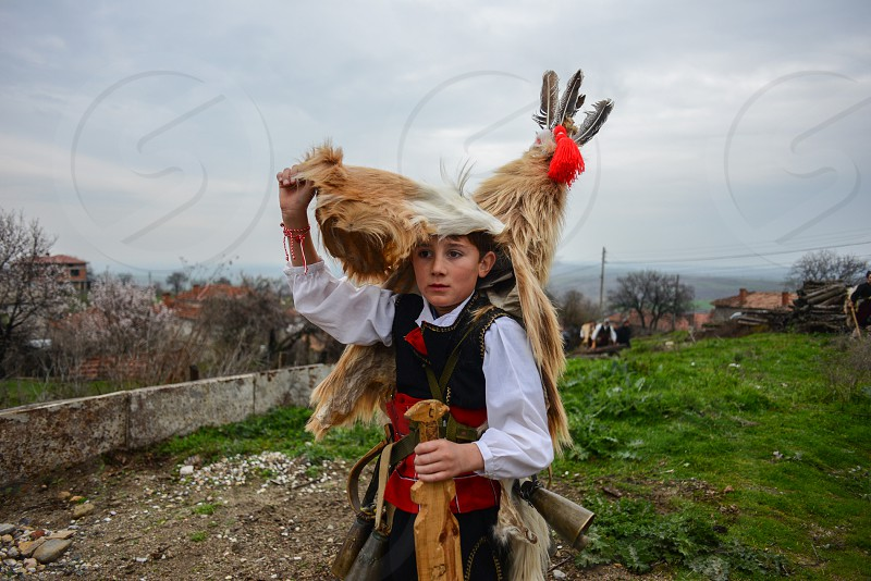 Kukeri Ivaylovgrad Bulgaria. Every Spring the men and boys of the villages dress up in costume to scare away the bad spirits. Clad in animal furs swords and bells they do a convincing job.  photo