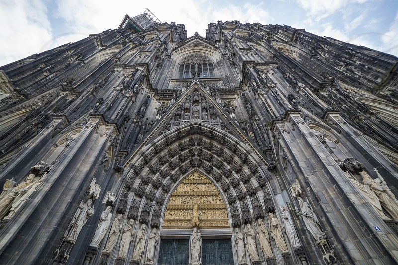 Facade of the Cathedral Church of Saint Peter Catholic cathedral in Cologne bottom view photo