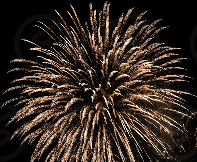 brown fireworks display selective focus photography photo