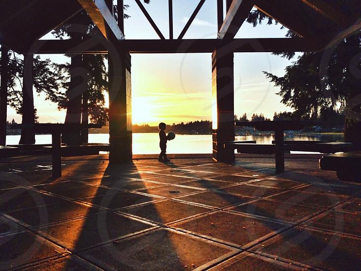 brown wooden gazeebo on sunset view photo