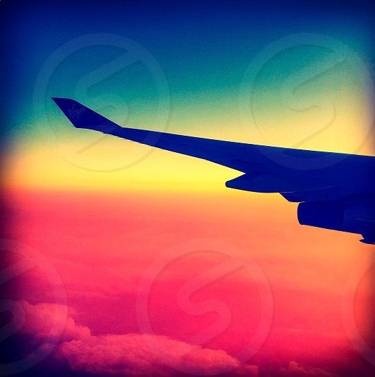 Outdoor day landscape horizontal square filter colour colourful vivid vibrant bright wing flight plane airplane aeroplane sky sunset earth height view vista clouds travel tourist tourism wanderlust photo