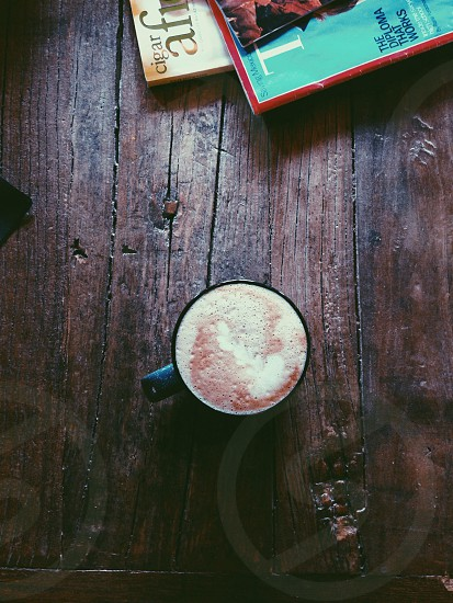 black mug with frothy content photo