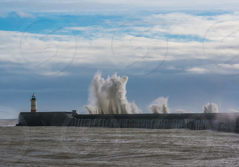 Storm waves wall harbour sea ocean wild photo