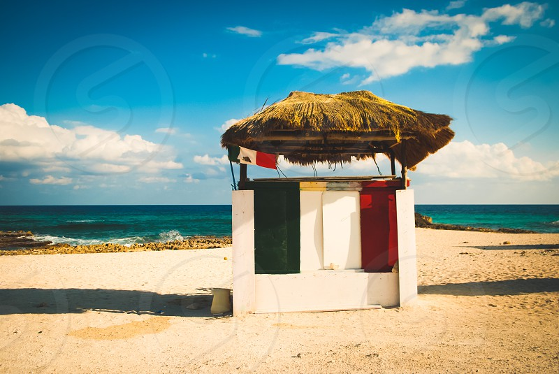 Green white and red roadside stand on the beach in Cozumel Mexico. photo
