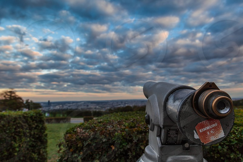 1st person perspective of rpg game through telescopic rifle aiming towards dark clouds photo