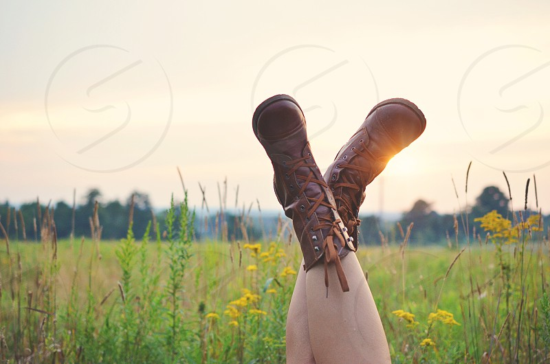human foot with brown boots photo