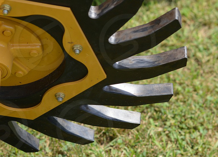 black and yellow grinder blade photo