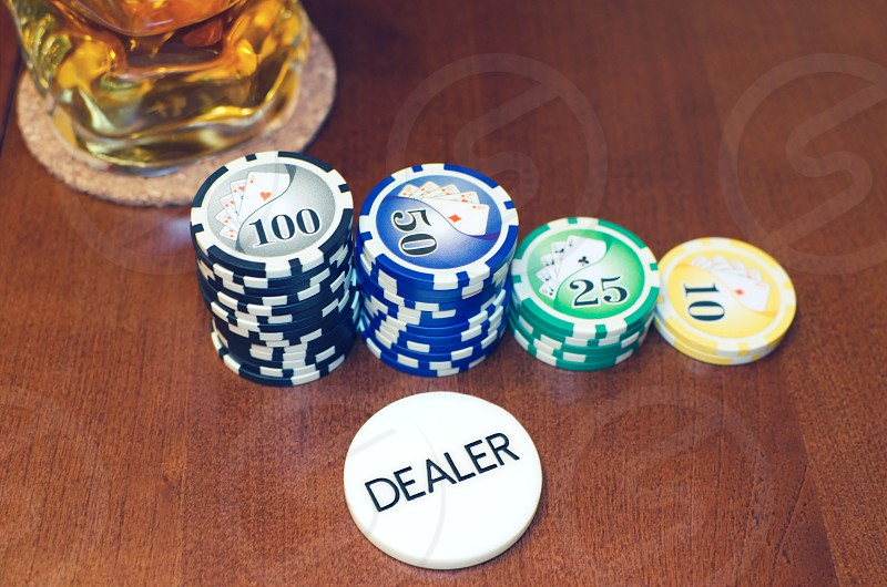 addiction bet betting black button chance chip chips close close-up color dealer drink em gamble gambling game games glass hold leisure luck nobody photography play playing poker red risk stack success table texas up white win wooden  photo