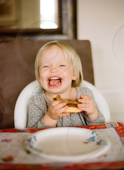 toddler laughing expression girl playful  photo