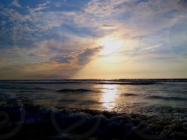 Sun meets the sea :) I went to La Union province here in the Philippines to take some short breaks from work. This is the China Sea in La Union. :) photo
