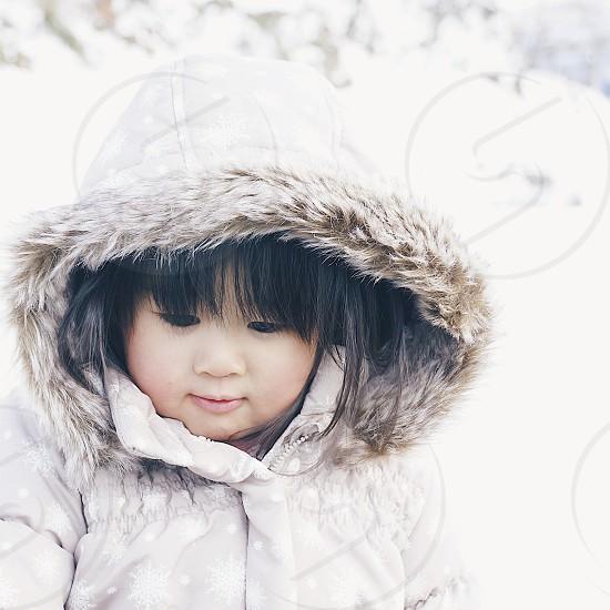 baby in white fur trim hood parka photo