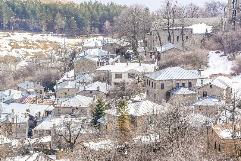 Traditional Snowy Village In Winter - Nymfaio Florina Greece photo