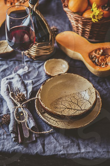 Autumn table setting with pumpkins. Thanksgiving dinner and autumn decoration photo