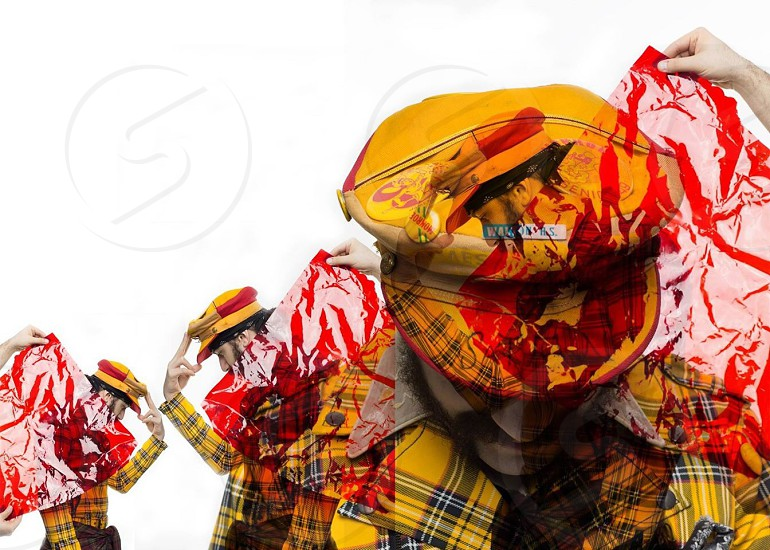 person in yellow and black plaid hat photo
