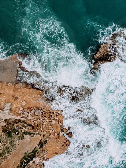 Aerial drone view video of sea near beach with birds fly Attica Greece photo