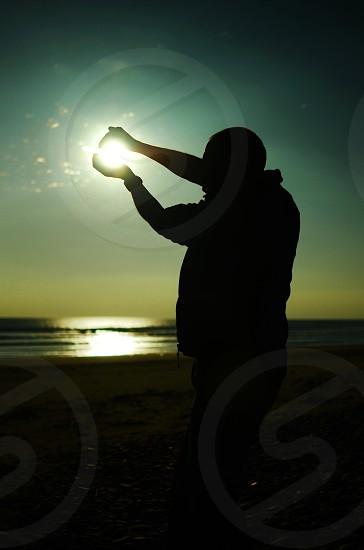 Holding the sun. photo