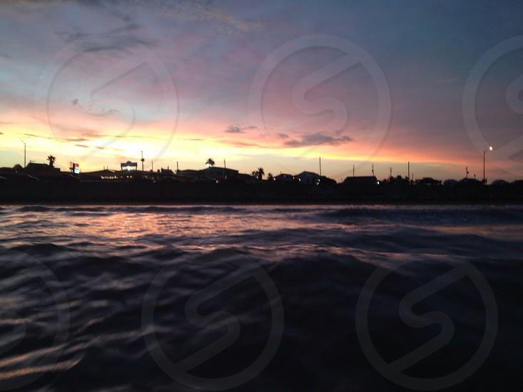 Sunset in Galveston boardwalk  photo