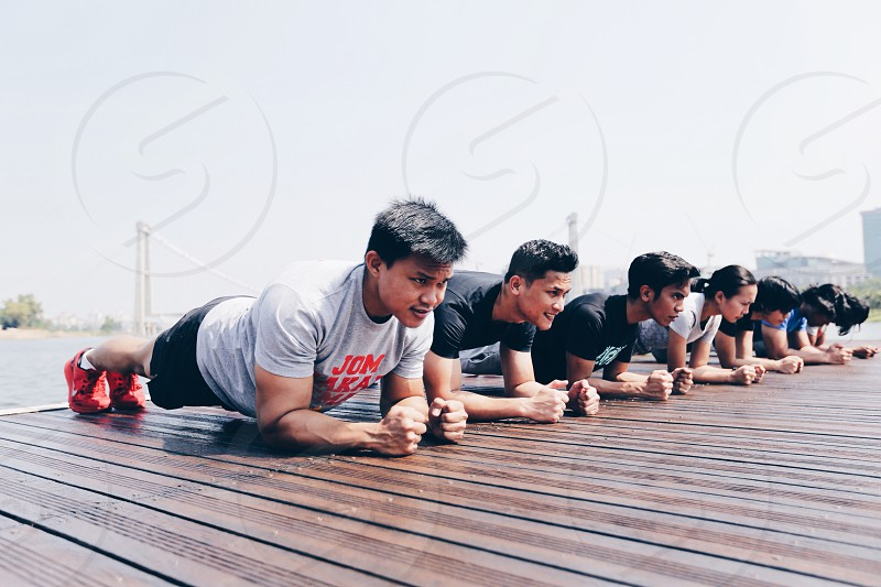 Planking is good for your abs. A better result if you're doing it with a group of friends. While you can motivate each other.  photo