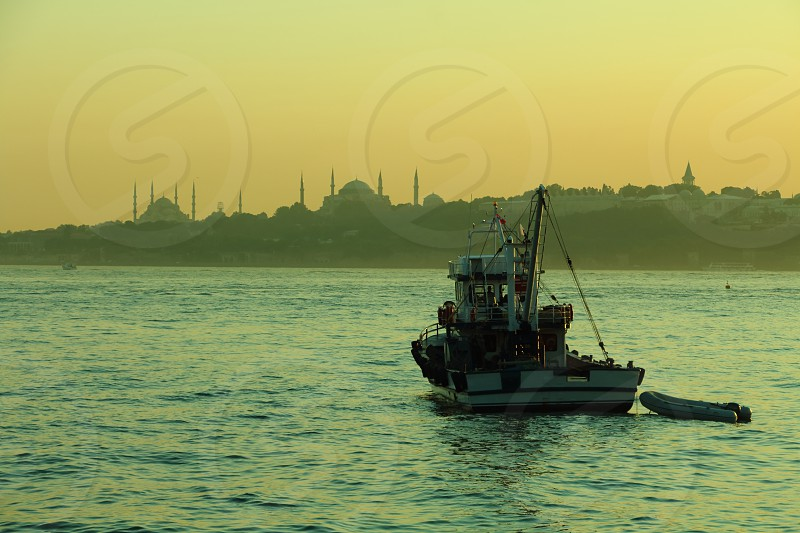boat moored at sunset in front of istanbul photo