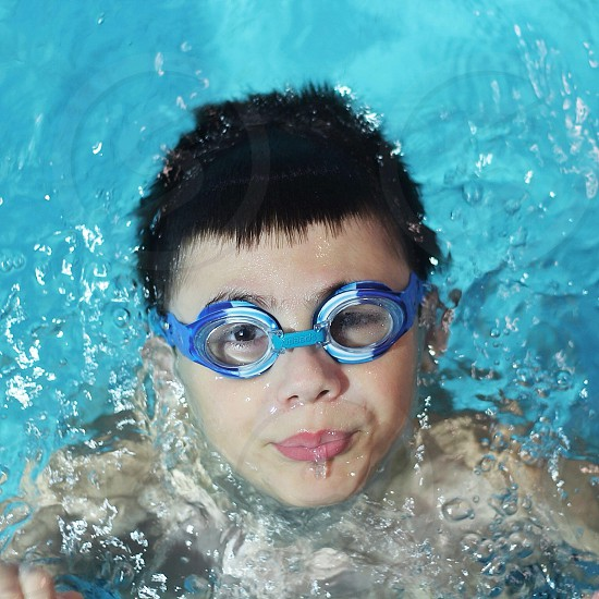 person wearing swimming goggles photo