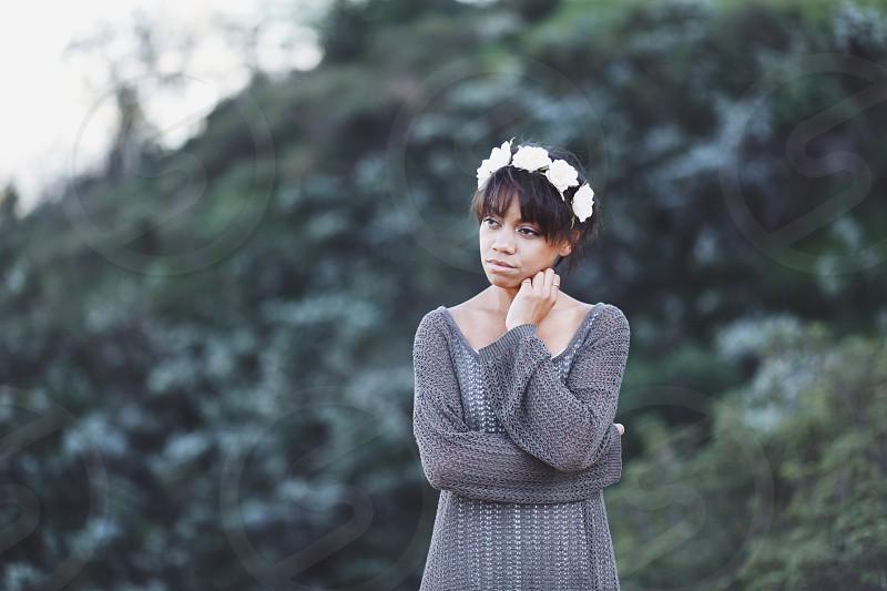 woman wearing gray knit dress posing during daytime photo