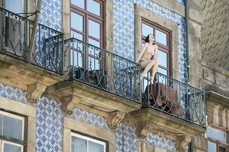 a naket women pupet on a balcony in Ribeira in the city centre of Porto in Porugal in Europe. photo