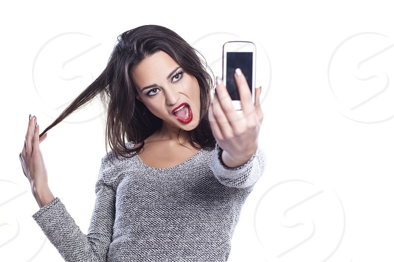 pretty girl take a self portrait with her smart phone photo
