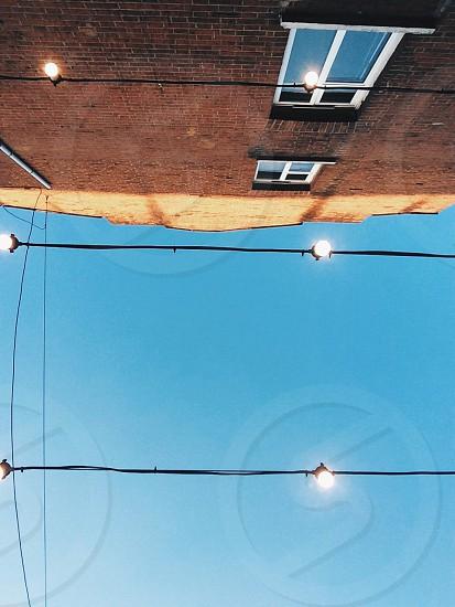 house brick sky light bulb bulb  photo