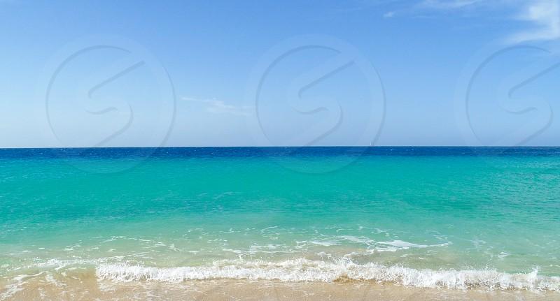 beach and sea blue waters blue skies half split photo