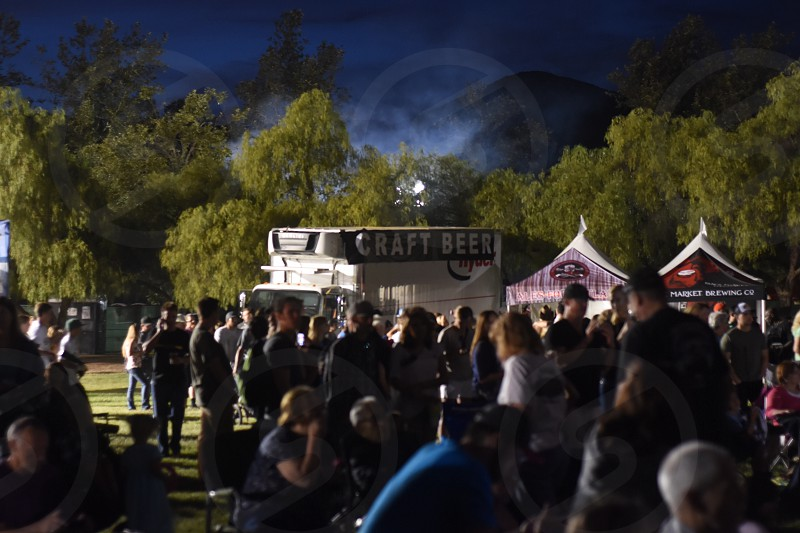 people standing near craft beer stall during night photo