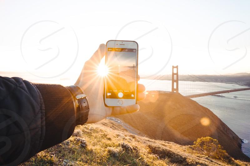 iPhone shot of San Francisco Bay at sunrise. Golden Gate bridge in the background. photo